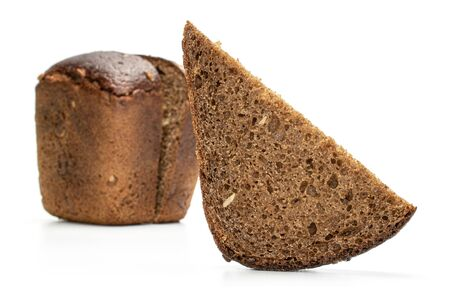 Group of two halves one slice of fresh baked dark bread front focus isolated on white background