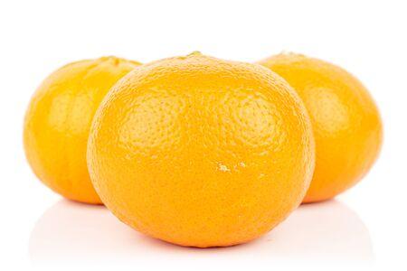 Group of three whole fresh orange mandarine isolated on white background