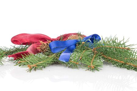 Lot of whole christmas green branch spruce with red ribbon and blue ribbon isolated on white background Stok Fotoğraf