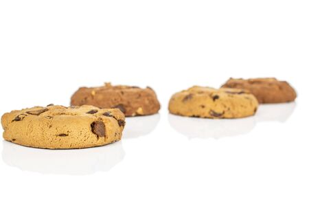Group of four whole sweet brown cookie front focus isolated on white background