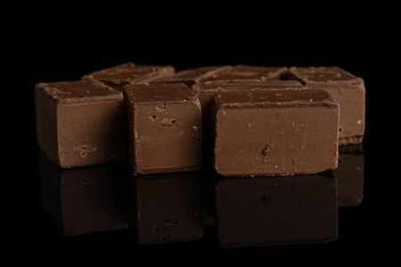 Lot of whole sweet brown viennese nougat isolated on black glass