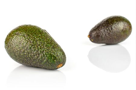 Group of two whole fresh green avocado isolated on white background Stock fotó