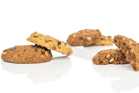 Group of four whole two halves of sweet brown cookie isolated on white background