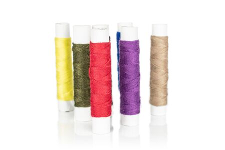Group of six whole sewing thread spool isolated on white background 写真素材