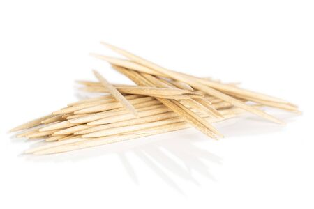 Lot of whole disordered wooden brown toothpick isolated on white background