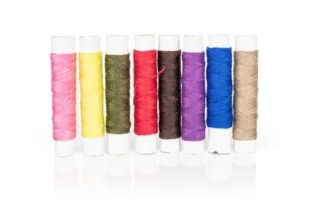 Group of eight whole sewing thread spool isolated on white background