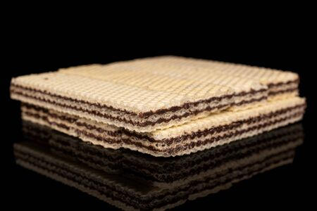 Lot of whole sweet chocolate biscuit wafer isolated on black glass