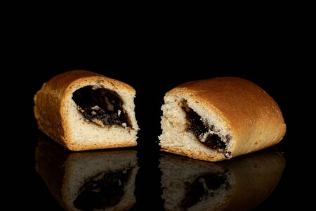 Group of two whole sweet czech bun isolated on black glass Banque d'images
