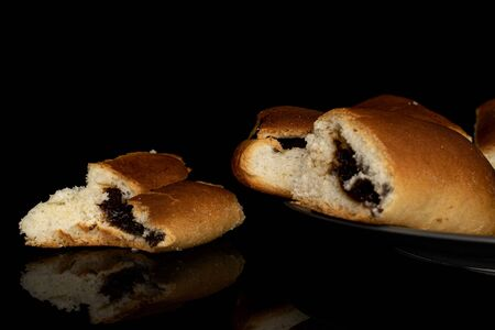 Group of four whole sweet czech bun on gray ceramic plate isolated on black glass Banque d'images
