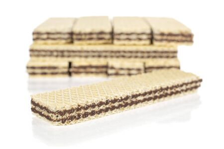 Lot of whole sweet chocolate biscuit wafer one in focus isolated on white background