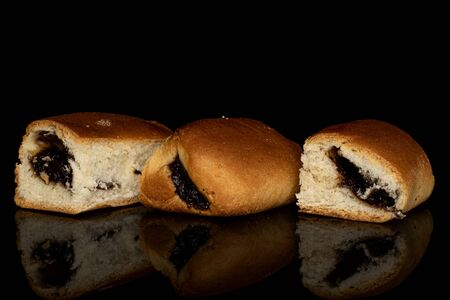 Group of three whole sweet czech bun isolated on black glass Banque d'images