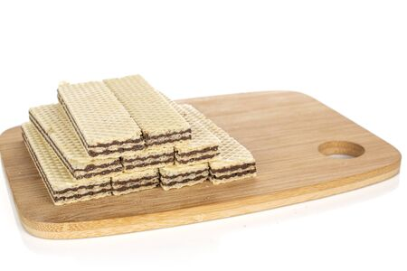 Group of nine whole sweet chocolate biscuit wafer on bamboo cutting board isolated on white background Stock fotó