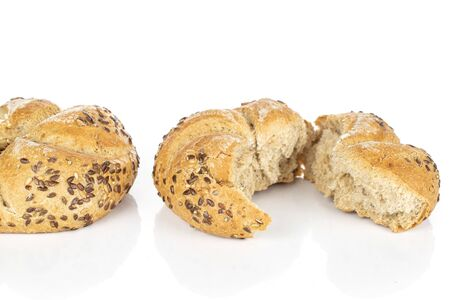 Group of one whole two halves of sesame kaiser roll isolated on white background