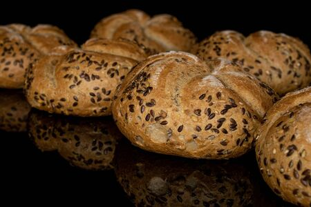 Group of six whole sesame kaiser roll isolated on black glass Stock fotó