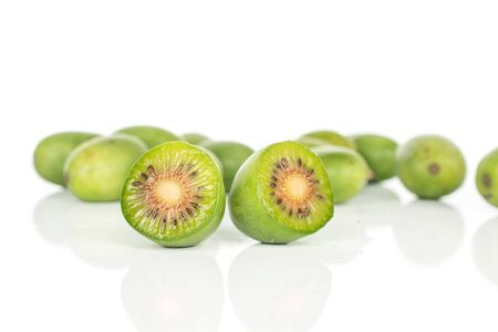 Group of lot of whole two halves of hardy green kiwi isolated on white background 写真素材