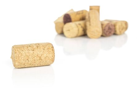 Lot of whole common wine cork front focus isolated on white background