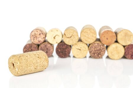 Lot of whole common wine cork wall isolated on white background