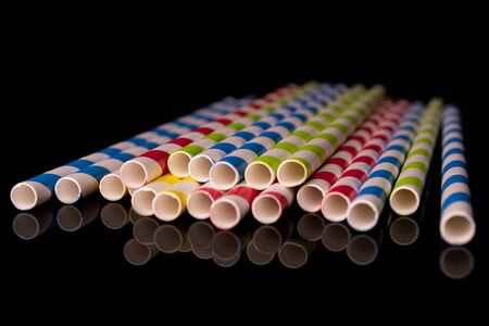 Lot of whole paper straw isolated on black glass Reklamní fotografie