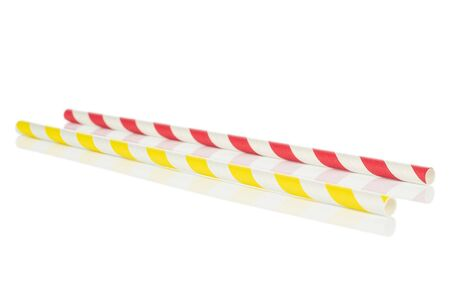 Group of two whole red yellow paper straw isolated on white background