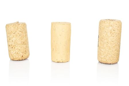 Group of three whole common wine cork isolated on white background
