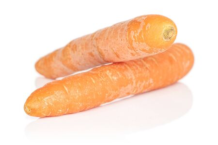 Group of two whole fresh orange carrot isolated on white background Stock Photo