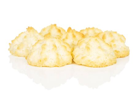 Lot of whole homemade golden coconut biscuit isolated on white background Stock Photo