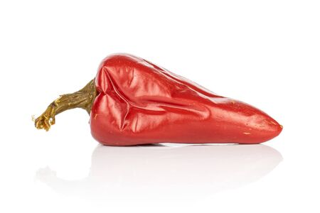 One whole pickled red pepper isolated on white background