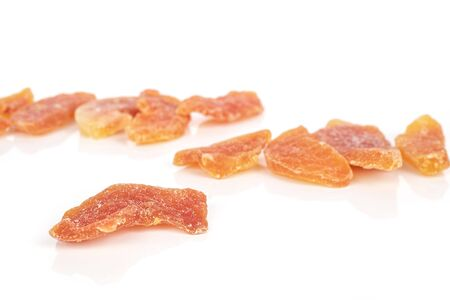 Lot of whole dried orange papaya piece front focus isolated on white background Reklamní fotografie - 136233746