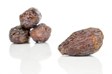Group of four whole dried brown date fruit one in front isolated on white background Reklamní fotografie - 136233777
