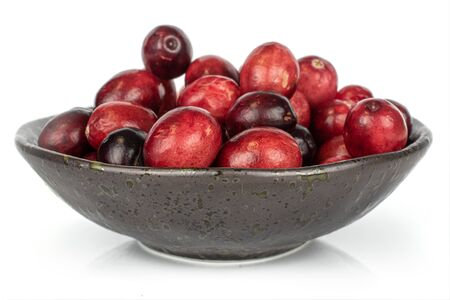 Lot of whole fresh red cranberry in glazed bowl isolated on white background Reklamní fotografie