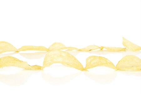 Lot of whole crisp potato chip two lines isolated on white background