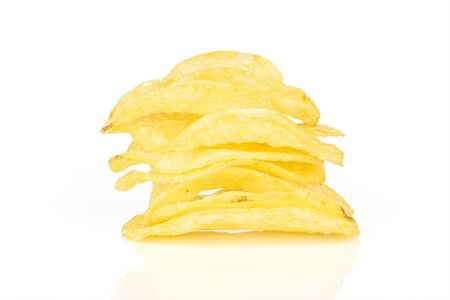 Lot of whole crisp potato chip tower isolated on white background