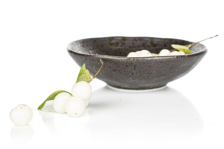 Lot of whole bright white snowberry in glazed bowl isolated on white background Reklamní fotografie