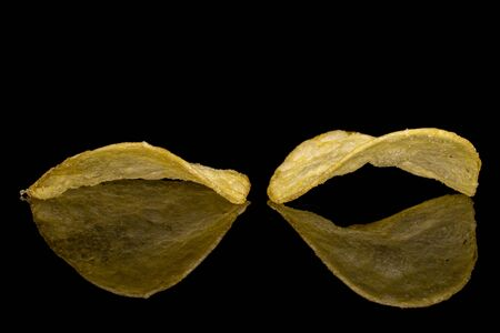 Group of two whole crisp potato chip isolated on black glass Reklamní fotografie - 136233292