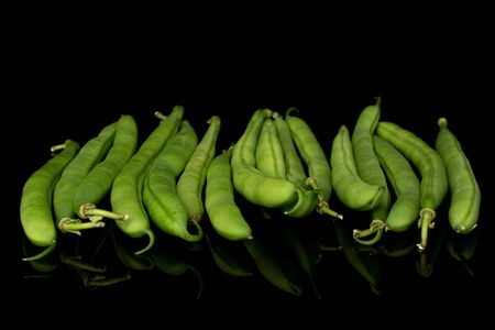 Lot of whole snap green bean isolated on black glass Reklamní fotografie