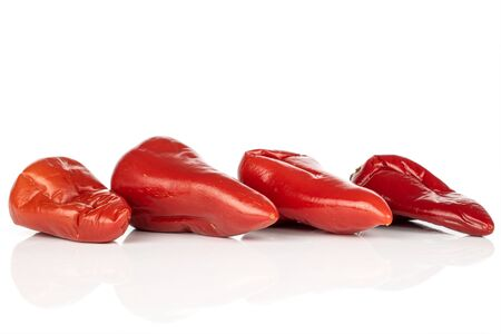Group of four whole pickled red pepper line isolated on white background Reklamní fotografie - 136233294