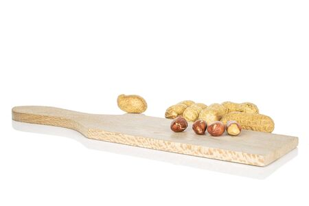 Group of lot of whole three pieces of tasty beige peanut on wooden cutting board isolated on white background Reklamní fotografie - 136233760