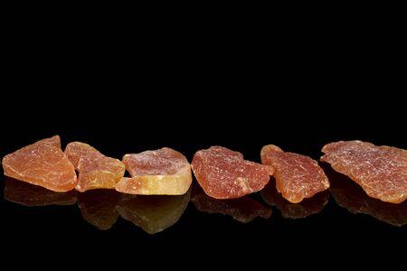 Group of six whole dried orange papaya piece isolated on black glass Reklamní fotografie - 136233716