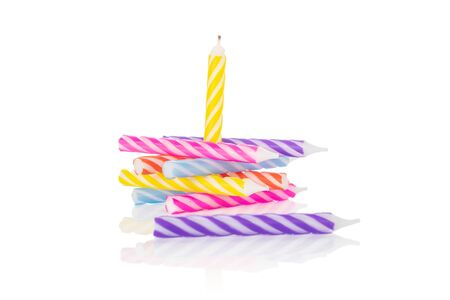 Lot of whole birthday cake candle folded isolated on white background Stock Photo