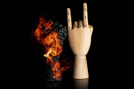 Struggle sign in burning fire isolated on black glass