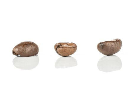 Group of three whole fresh coffee bean isolated on white background
