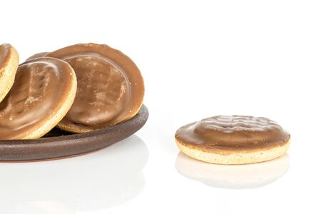Group of four whole chocolate biscuit with brown ceramic coaster isolated on white background Banque d'images