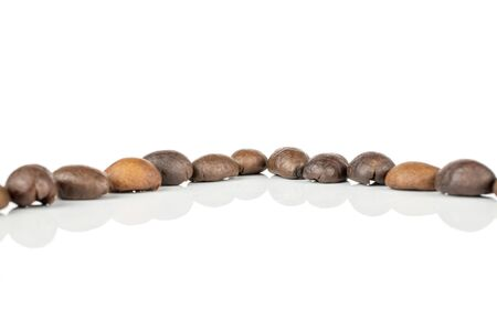 Lot of whole fresh coffee bean isolated on white background