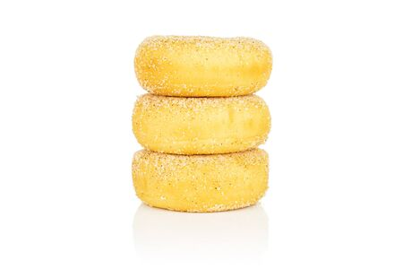 Group of three whole sweet golden mini cinnamon donut in column isolated on white background