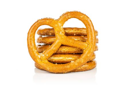 Group of six whole salty brown pretzel isolated on white background