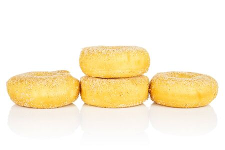 Group of four whole sweet golden mini cinnamon donut isolated on white background