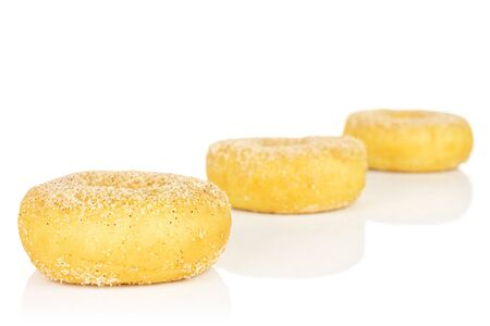 Group of three whole sweet golden mini cinnamon donut isolated on white background Reklamní fotografie