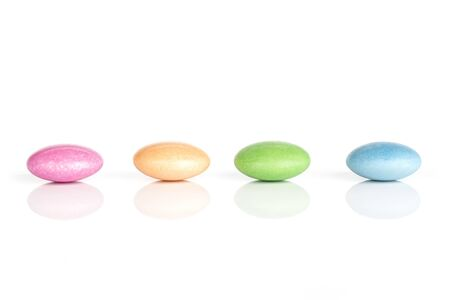 Group of four whole sweet colourful candy isolated on white background