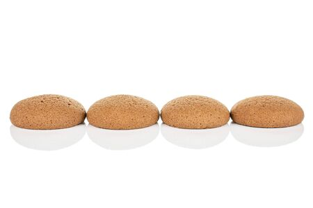 Group of four whole sweet brown chocolate sponge biscuit isolated on white background
