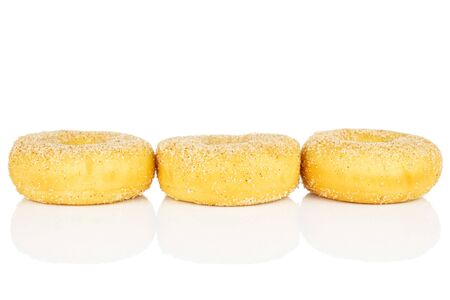 Group of three whole sweet golden mini cinnamon donut in row isolated on white background Reklamní fotografie